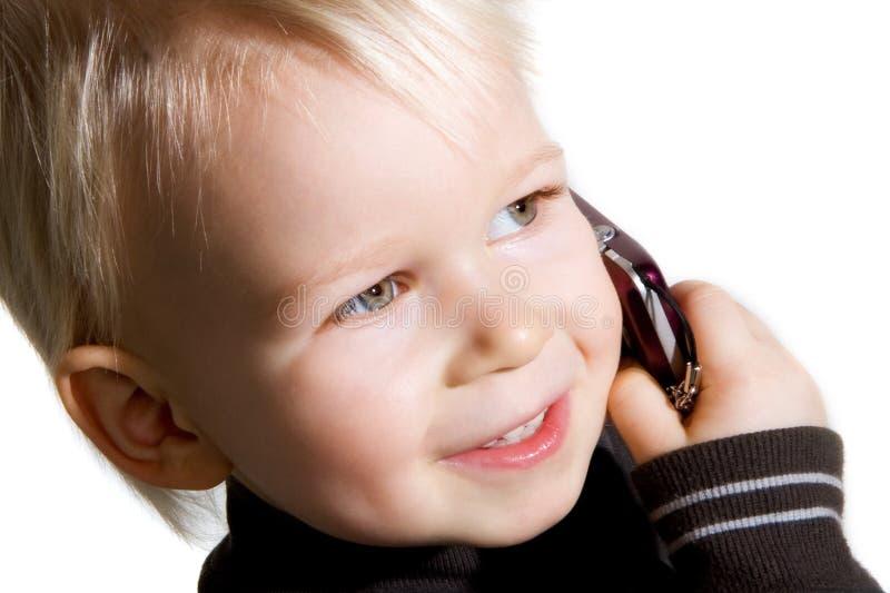 Bambino sul telefono immagine stock libera da diritti