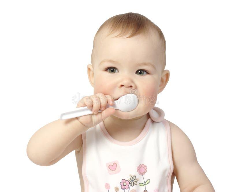 Bambino sveglio con il cucchiaio fotografie stock libere da diritti