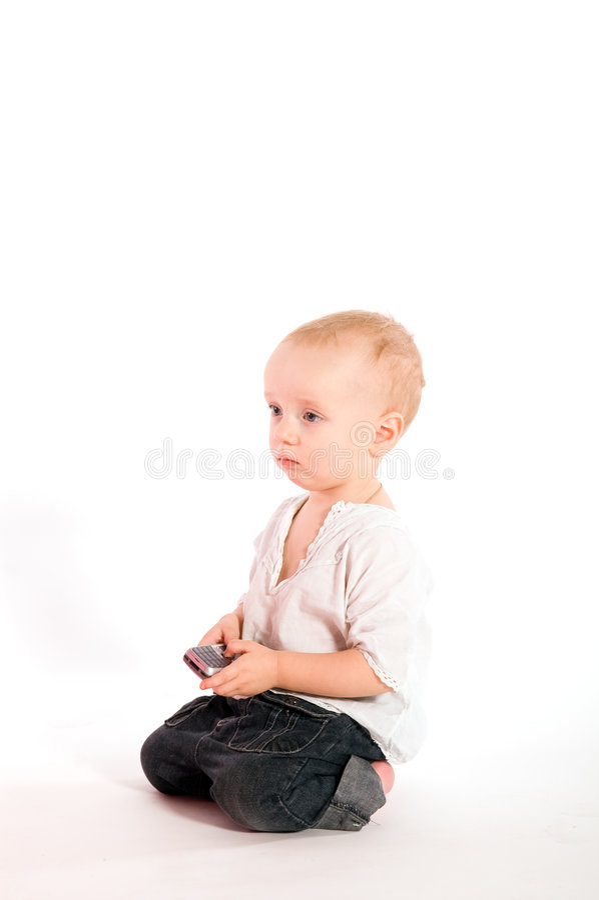 Bambino triste con il telefono immagine stock
