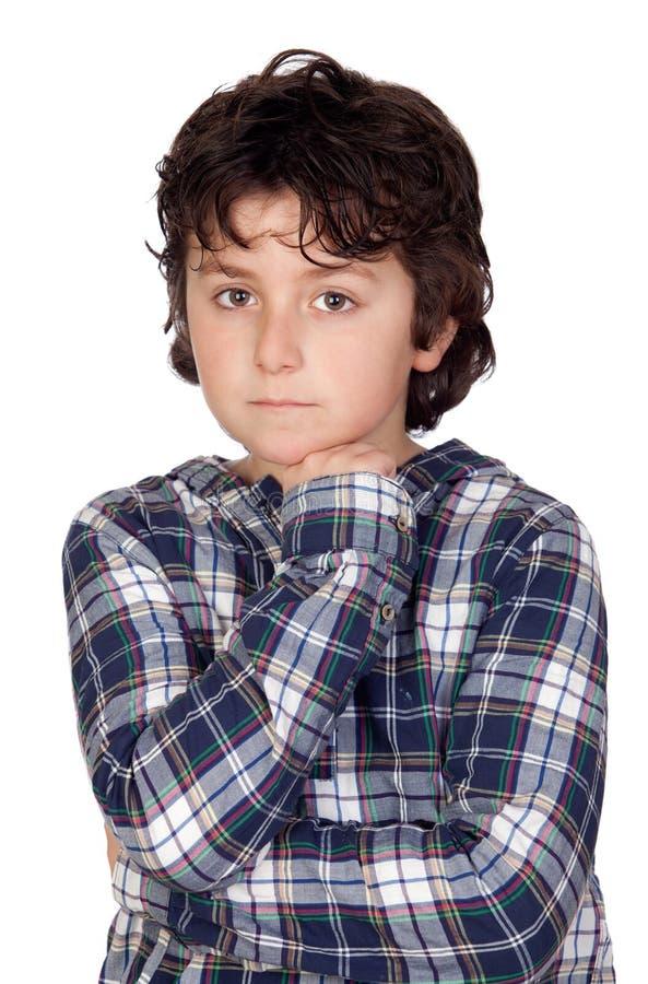 Bambino triste con la maglietta del plaid fotografia stock