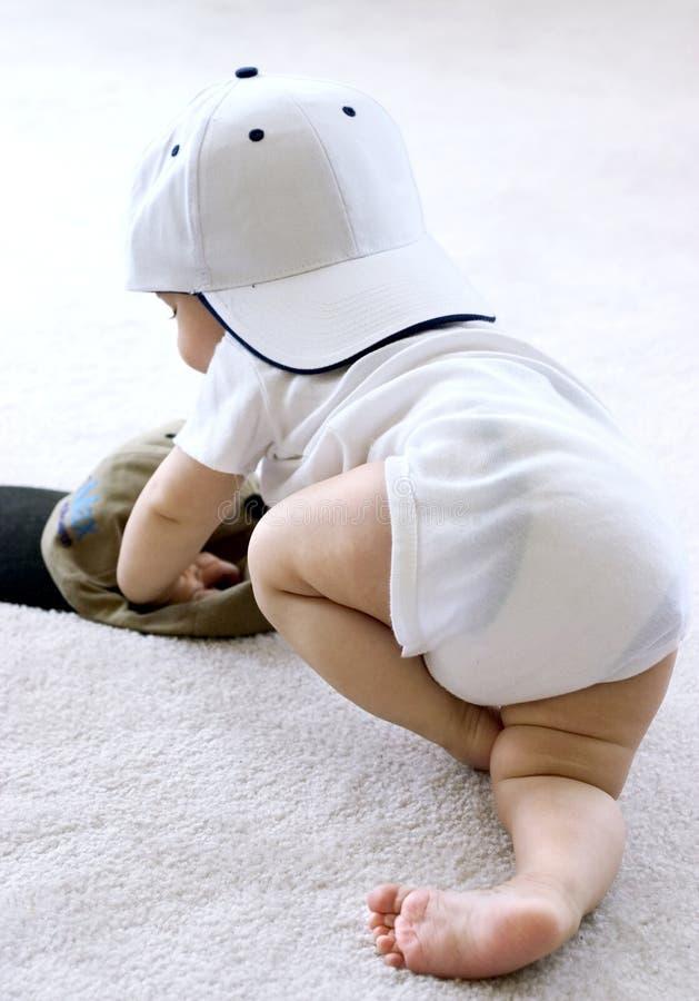 Bambino in un berretto da baseball fotografie stock