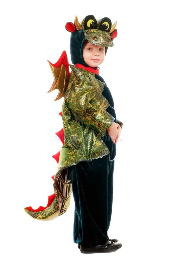 Bambino in un costume del drago fotografia stock