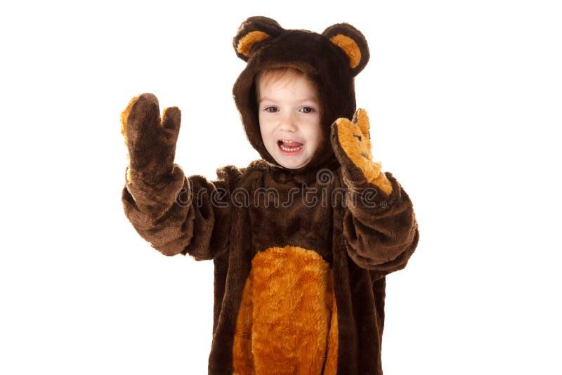 Bambino in un costume dell'orso di carnevale di natale isolato su bianco con lo spazio della copia, gioia fotografia stock libera da diritti