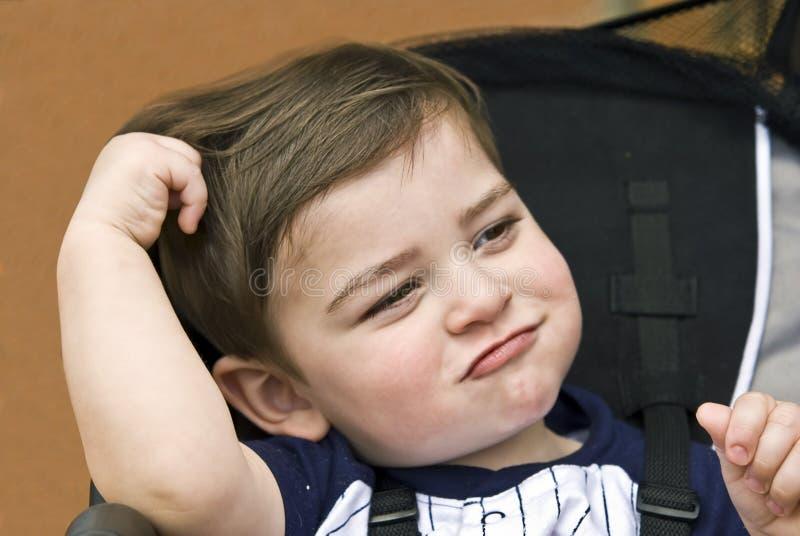 Bambino in un passeggiatore fotografia stock libera da diritti