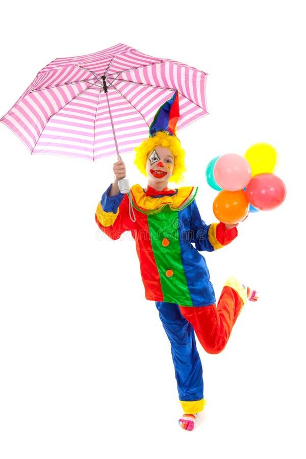 Bambino vestito come pagliaccio divertente variopinto immagine stock libera da diritti