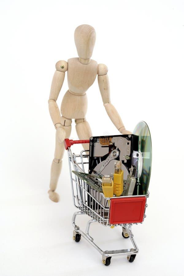 Bambola congiunta con il carrello di acquisto fotografie stock libere da diritti
