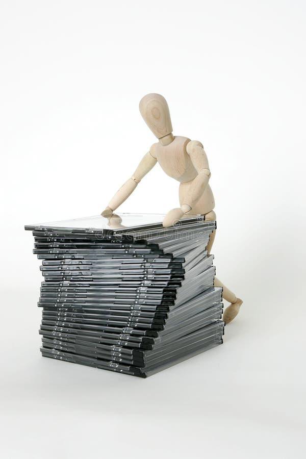 Bambola congiunta con la pila cd fotografia stock