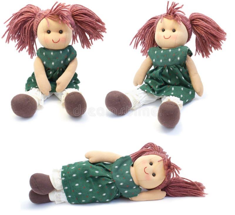 Bambola fatta a mano. collage fotografie stock libere da diritti