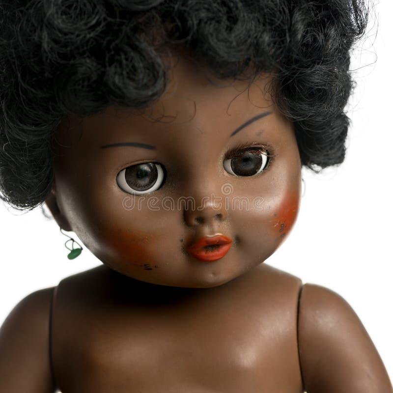 Bambola nera utilizzata davanti ad un fondo bianco immagine stock libera da diritti