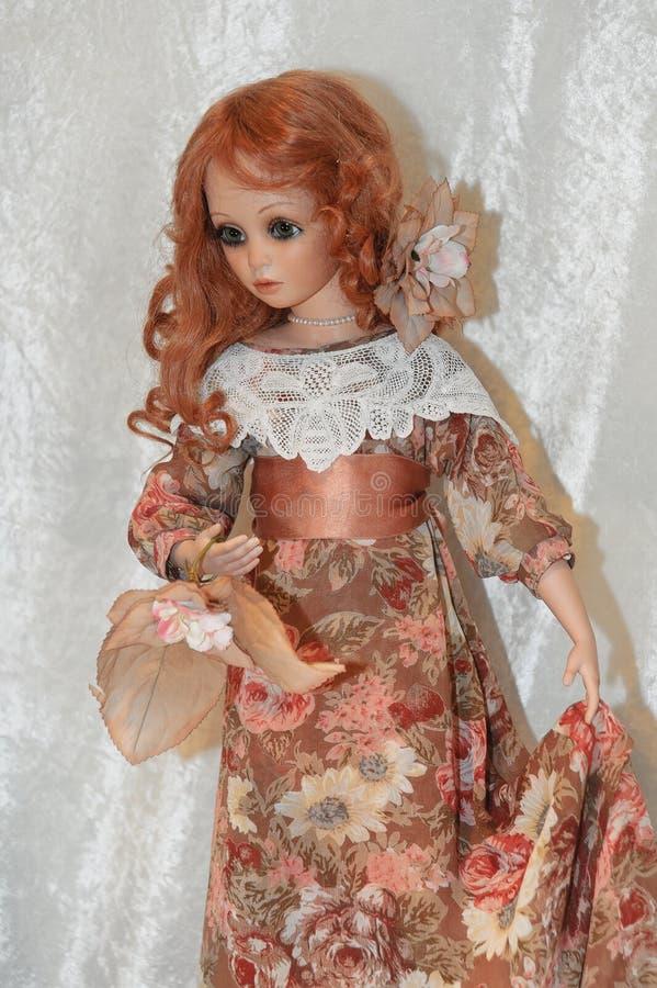 Bambola in retro vestito fotografie stock