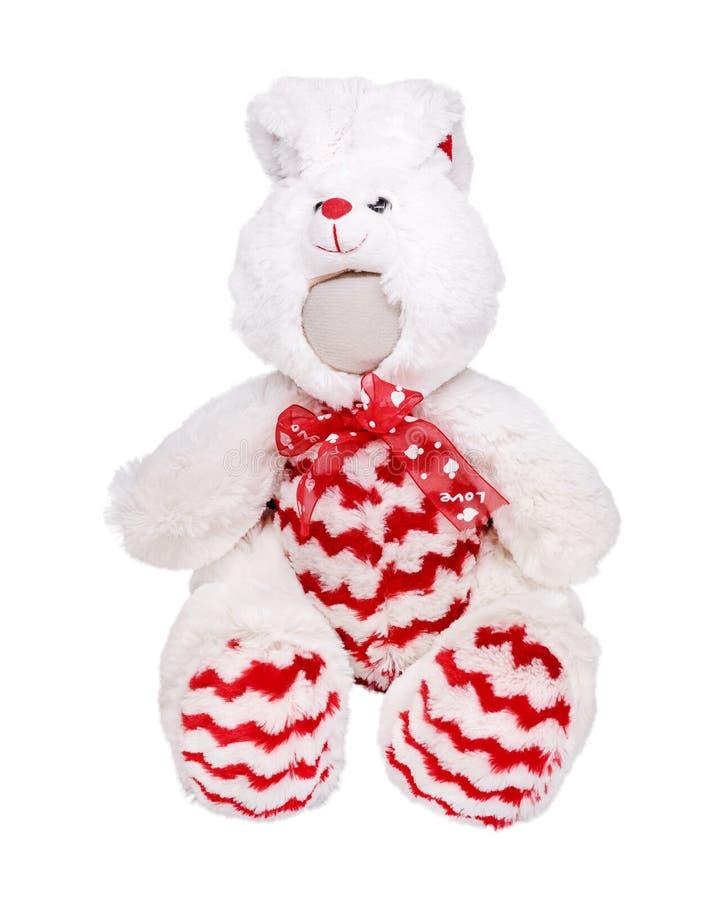 Bambola sveglia del coniglietto isolata su fondo bianco Giocattolo del coniglio con il nastro rosso immagine stock libera da diritti