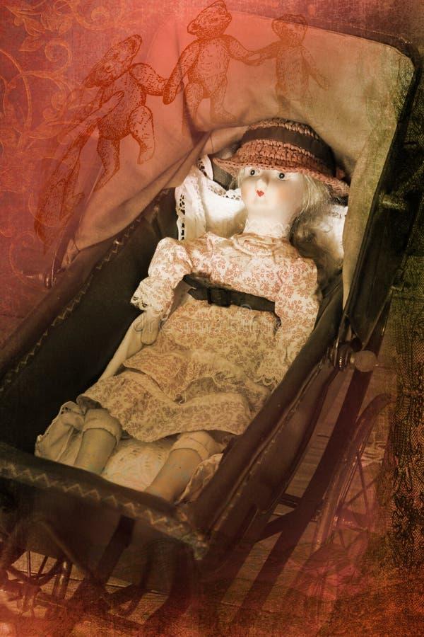 Bambola vittoriana in una carrozzina fotografie stock