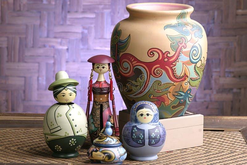 Bambole e vaso artistici fotografia stock