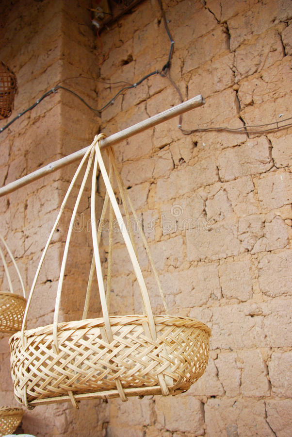 Bamboo basket. In the courtyard of a rural family royalty free stock images
