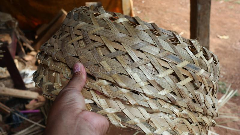 Bamboo basket craftswoman while doing his work stock images