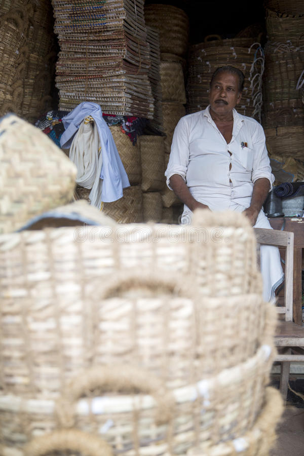 Bamboo basket manufacturer in Varkala, India. Unidentified bamboo basket maker in Varkala, India. Bamboo- based industries in India provide employment to about royalty free stock image