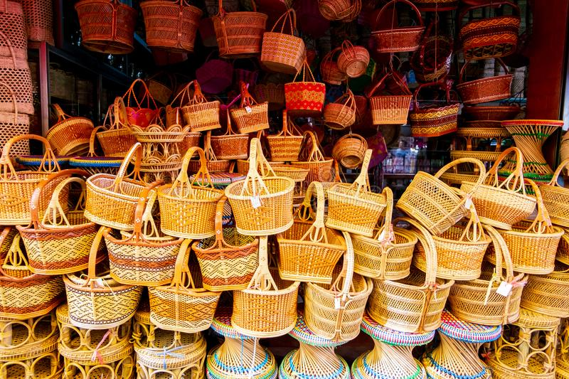 Bamboo basketwork product the famoust souvenir of thailand. Such as straw bags, basketwork, wicker baskets handmade in local material shop at the traditional stock image