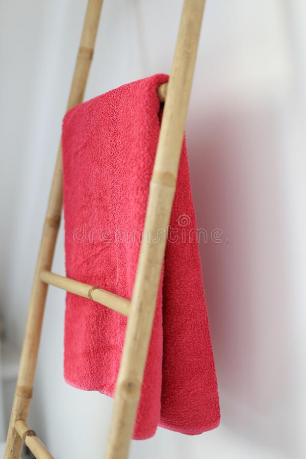 Modern natural Bamboo bathroom towel rack. A modern natural  Bamboo bathroom towel rack stock images