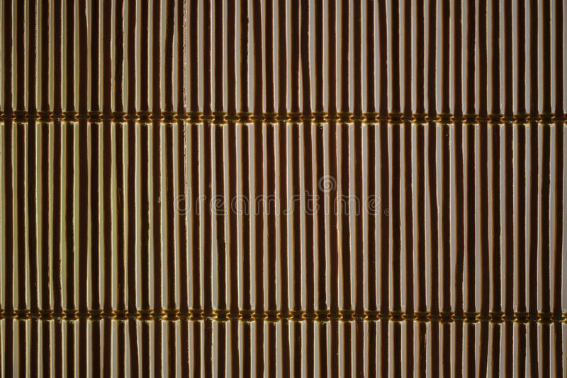 Bamboo blinds and sunlight bursting through them. Background from bamboo thin blinds with penetrating sun rays royalty free stock photo