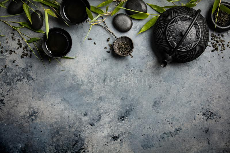 Bamboo branches and green tea on concrete background stock images