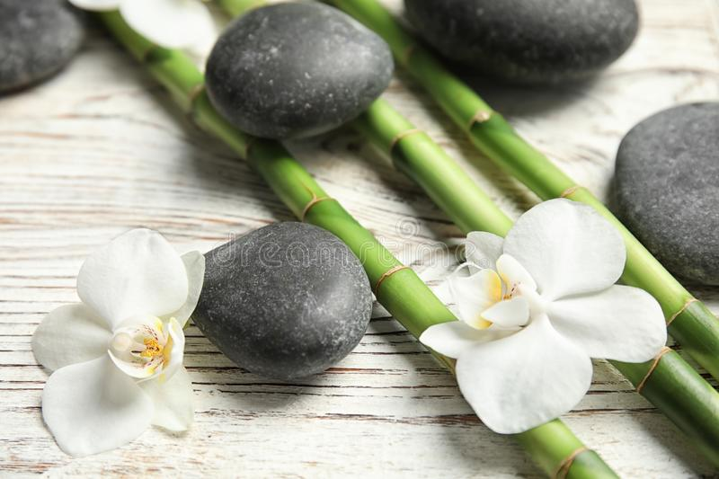 Bamboo branches, spa stones and flowers royalty free stock images