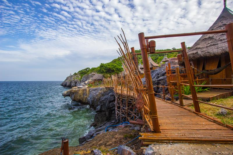 Bamboo bridge and Borneo style huts at Koh Sichang,Chonburi,Thailand. Koh Sichang is the island in Chonburi province,Thailand.It is in the Gulf of Thailand,12 km stock photography