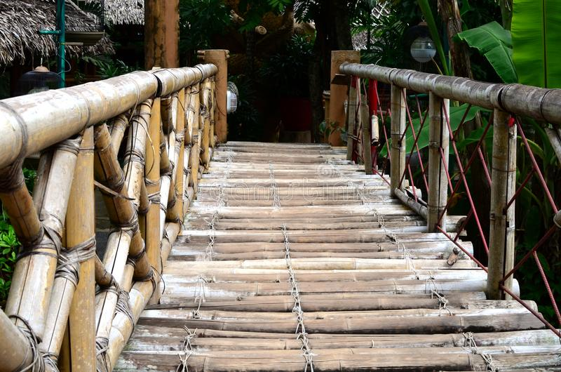Bamboo bridge serves as footh path and decoration in an Asian aquatic jungle theme park. Calauan Laguna, Philippines - August 28, 2016: Bamboo bridge serves as royalty free stock image