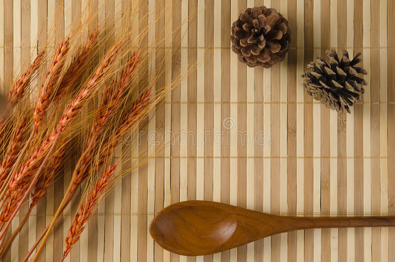 Bamboo brown straw with cones and barley rice grains stock photo