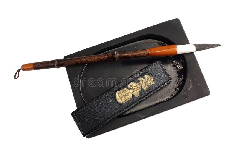 Bamboo caligraphy brush, ink stone and ink stick isolated on white. Asian bamboo calligraphy brush or pen with ink stone and ink stick isolated on a white royalty free stock photos