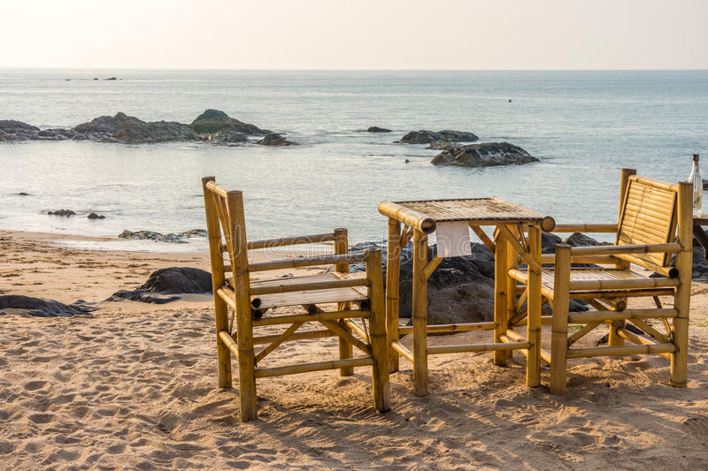 Bamboo chairs and table with clear sky on Pak Weep beach in the evening. The beach is in Southern Thailand royalty free stock images