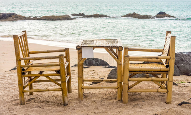 Bamboo chairs and table on Pak Weep beach. The beach is in Southern Thailand in the evening stock photo