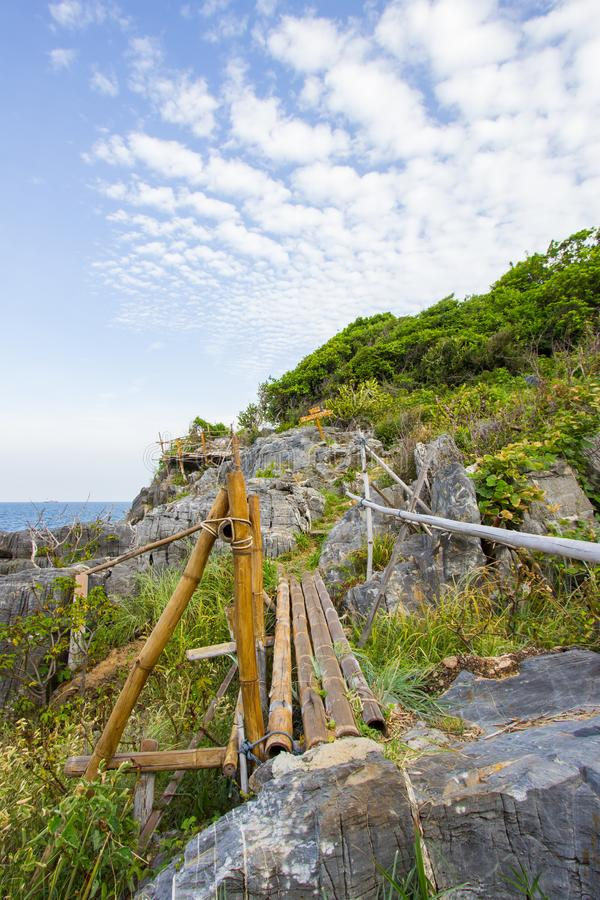 Bamboo fence on the cliff at Koh Sichang,Chonburi,Thailand.Non English texts mean `cliff for declaration of love`. Koh Sichang is the island in Chonburi province royalty free stock photos