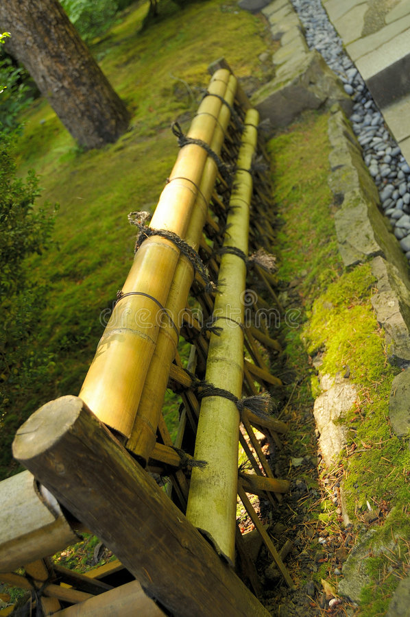 Bamboo Fencing in Garden. Bamboo Fencing and Landscaping in Oriental Garden stock images