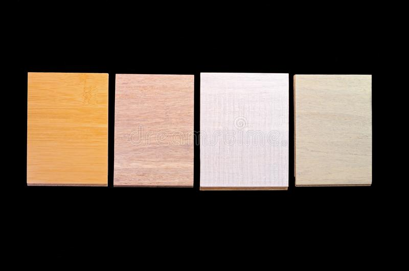 Bamboo flooring samples against black. Samples showing different styles and textures of bamboo flooring isolated against black background royalty free stock photo