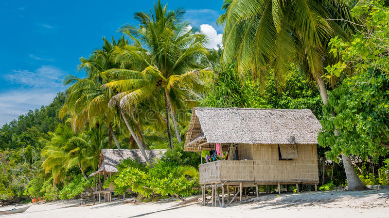 Bamboo Hut under Palm Trees of an Homestay on Gam Island, West Papuan, Raja Ampat, Indonesia.  royalty free stock photos
