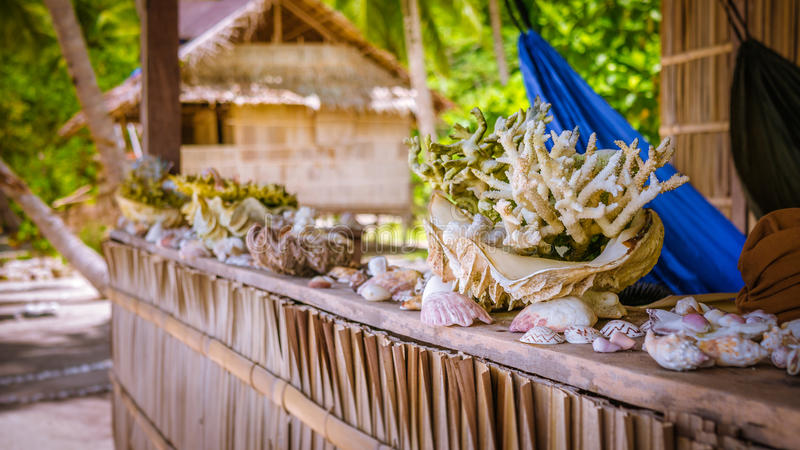 Bamboo Hut wih Sea Mussels and Corrals on Parapet of an Homestay on Gam Island, West Papuan, Raja Ampat, Indonesia.  stock images