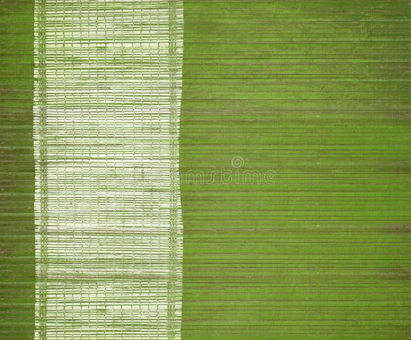 Bamboo mat with grunge white menu bar. Green bamboo mat with grunge white menu bar royalty free stock images