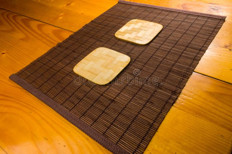 Bamboo Mat - stand food with bamboo stands for hot, close-up, wooden background. Brown bamboo Mat - stand food with bamboo stands for hot, close-up, macro royalty free stock images