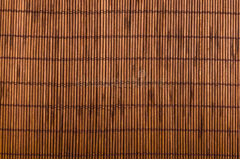 Bamboo Mat - stand food, close-up, wooden background. Brown bamboo Mat - stand food, close-up, macro, wooden background stock photography