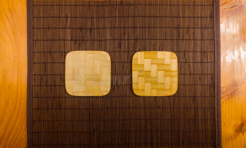 Bamboo Mat - stand food with bamboo stands for hot, close-up, wooden background. Brown bamboo Mat - stand food with bamboo stands for hot, close-up, macro stock images
