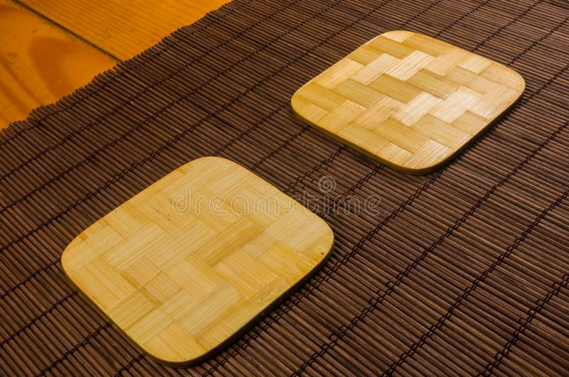 Bamboo Mat - stand food with bamboo stands for hot, close-up, wooden background. Brown bamboo Mat - stand food with bamboo stands for hot, close-up, macro stock image