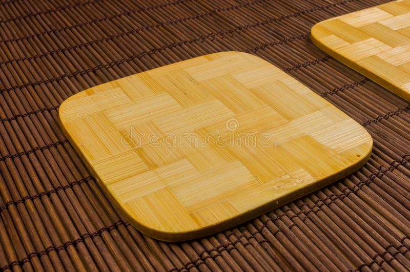 Bamboo Mat - stand food with bamboo stands for hot, close-up, wooden background. Brown bamboo Mat - stand food with bamboo stands for hot, close-up, macro stock photos