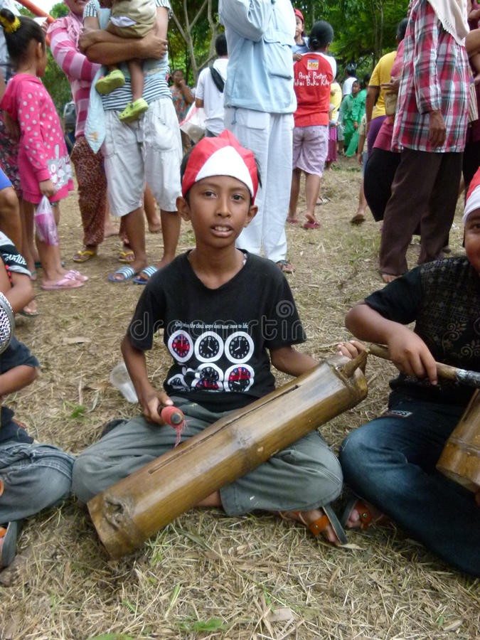 Bamboo music. Children play bamboo music when he joined the carnival culture event village in Sukoharjo, Central Java, Indonesia stock photography