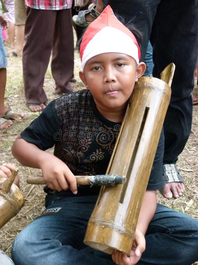 Bamboo music. Children play bamboo music when he joined the carnival culture event village in Sukoharjo, Central Java, Indonesia royalty free stock photos