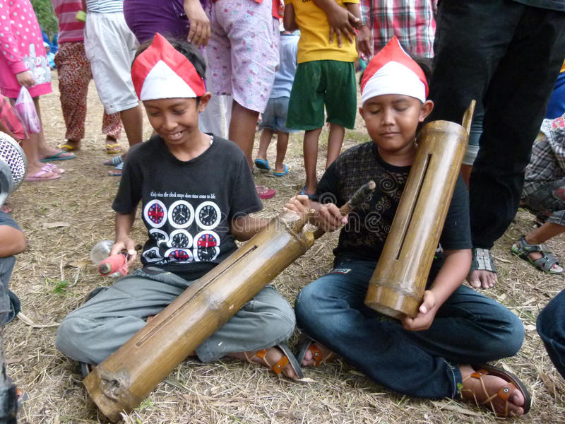 Bamboo music. Children play bamboo music when he joined the carnival culture event village in Sukoharjo, Central Java, Indonesia stock image