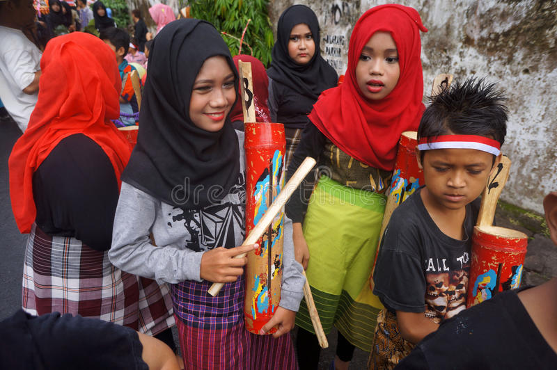 Bamboo music. Children were playing the bamboo music in a hometown parade in the city of Solo, Central Java, Indonesia stock photos