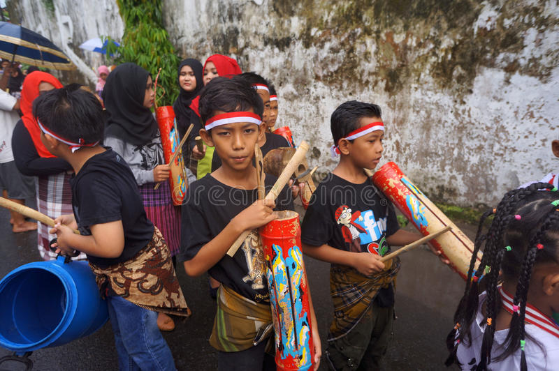 Bamboo music. Children were playing the bamboo music in a hometown parade in the city of Solo, Central Java, Indonesia stock image