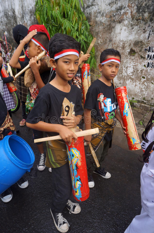 Bamboo music. Children were playing the bamboo music in a hometown parade in the city of Solo, Central Java, Indonesia royalty free stock images