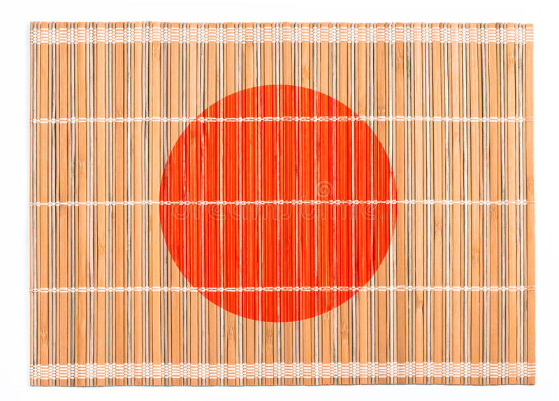 Bamboo placemat colored as Japanese flag stock image