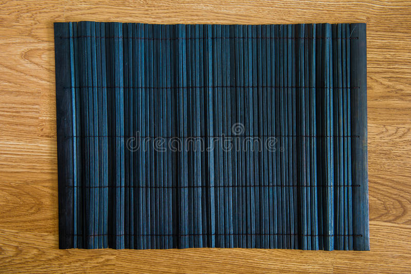 Bamboo placemat straw wood. On wooden background stock photography